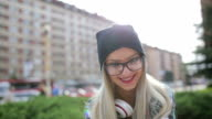 Smiling hipster blonde in the park video