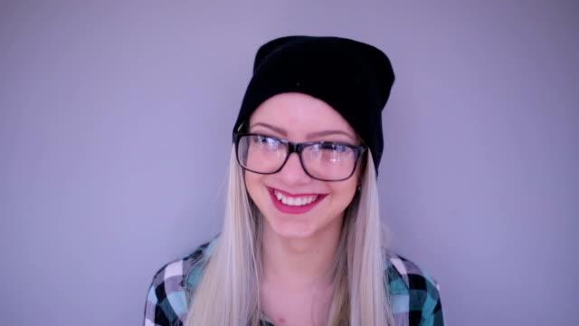 Smiling hipster blonde ,studio shot video
