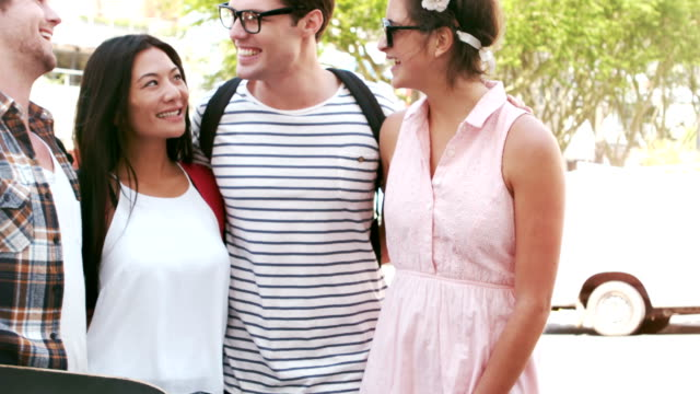 Smiling hipster friends standing together video