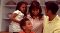 Smiling Hispanic family in the kitchen video