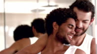 Smiling homosexual couple posing together video