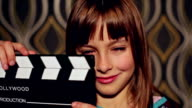 smiling little girl with a film slate video