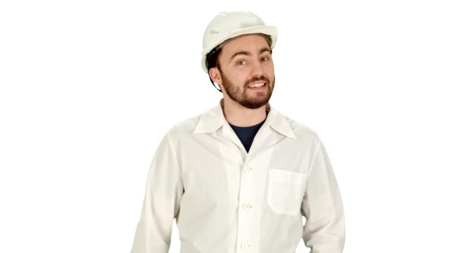 Smiling male architect with talking on camera on white background video