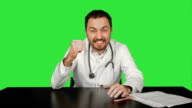 Smiling male doctor at medical office on a Green Screen, Chroma Key video