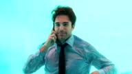 Smiling man having a phone call underwater video