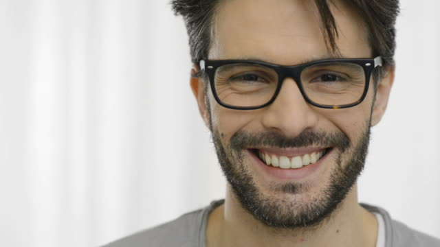 Smiling man with specs video