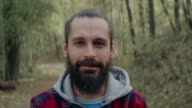 Smiling men standing in forest video