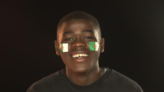 Smiling Patriotic Algeria male - HD & PAL video