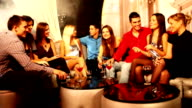Smiling people enjoying in communicate at night club. video