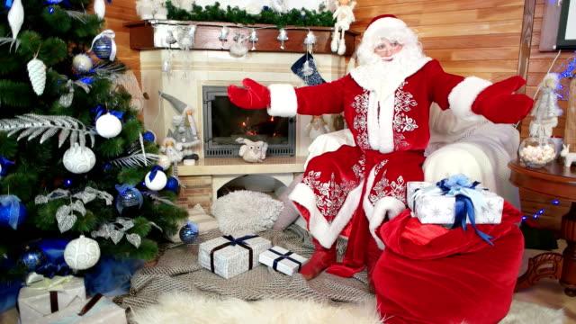 Santa hat hd video 4k b roll istock smiling santa welcomes his visitors santa claus greeting kids happy hospitable papa noel video m4hsunfo