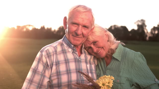 Smiling senior couple with bouquet video