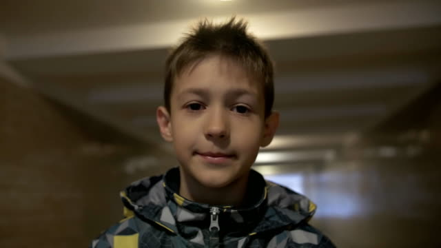 Smiling teenager looking at the camera, standing in the tunnel video