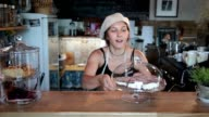 Smiling waitress showing a fresh tasty cheesecake video