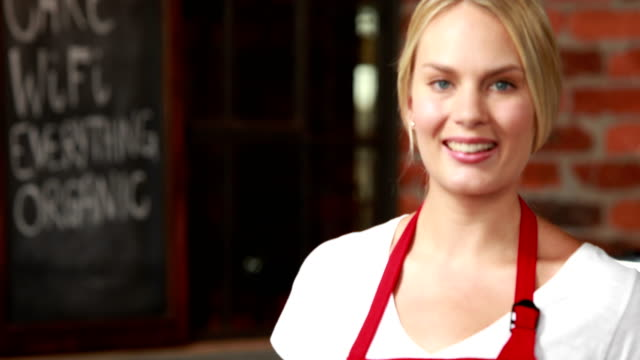 Smiling waitress winking at the camera video