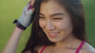 Smiling woman face. Closeup of asian woman smiling. Happy woman portrait outdoor video