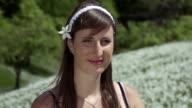 SLOW MOTION: Smiling woman in a flower field video