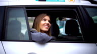 Smiling woman sitting in the cab video