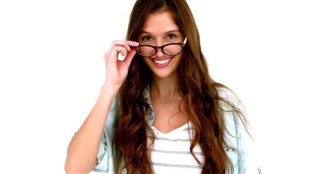 Smiling woman taking off eyeglasses video
