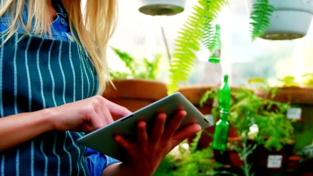 Smiling woman using digital tablet video