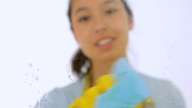 Smiling woman with cloth and spray bottle video