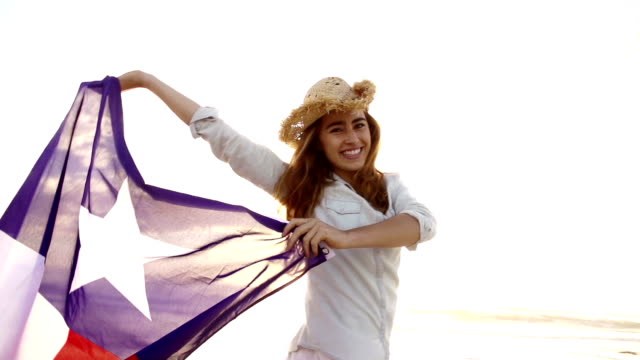 Smiling Woman with Texas state flag waving in the wind video