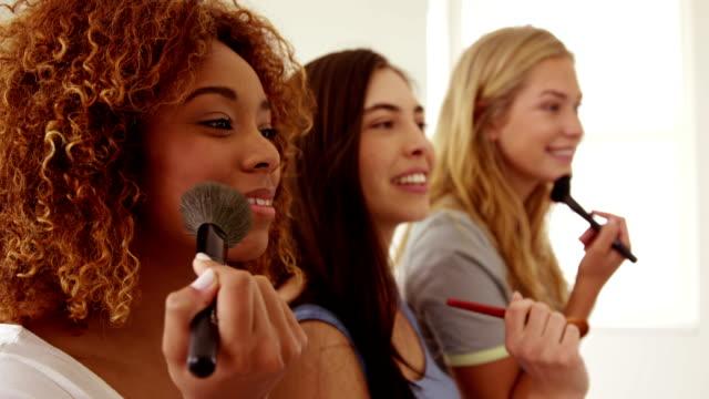 Smiling women applying make up video