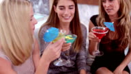Smiling women drinking cocktails video