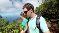 SELFIE: Smiling young couple on vacation hiking in jungle mountains in Hawaii video