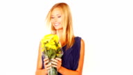Smiling young lady holding a bouquet video