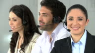 Smiling young woman at call center video