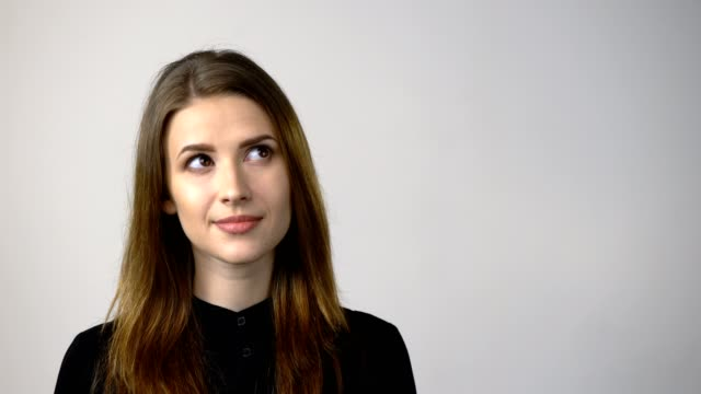 Smiling young woman looking at camera video