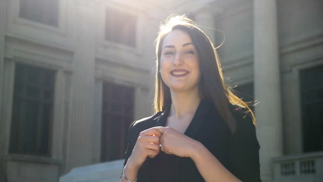 Smiling young woman shaking head and showing a nonverbal expression moving her index finger video