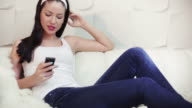 Smiling Young Woman Using Her Phone video