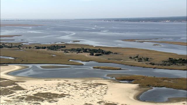 Smith Island Shoreline Leading To Cape Fear  - Aerial View - North Carolina,  Brunswick County,  United States video