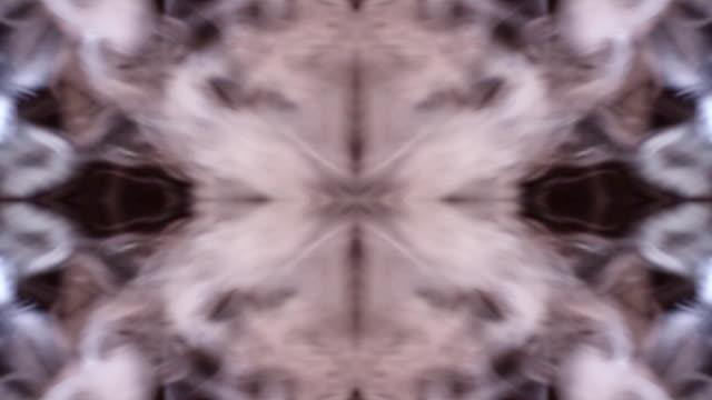 Smoke as eddy kaleidoscope against black background video