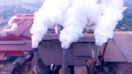 Smoke chimneys with white smoke while sugar produce video