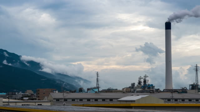 Smoke from factories rise as clouds roll video