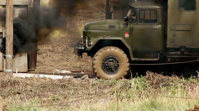 Smoke rising near Army Jeep video