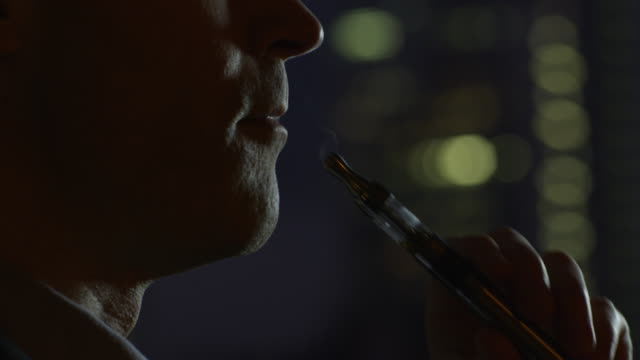 Smoking Electronic Cigarette at Evening. Close-up. video