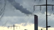 Smoking smoke stack of a power plant and power lines video