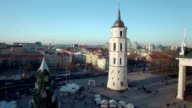 AERIAL. Smooth flight up Vilnius Cathedral and Belfry Tower, Vilnius, Lithuania. 2015 winter video