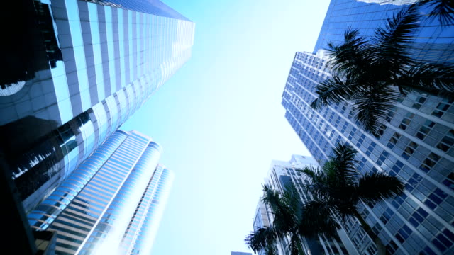 Smooth low angle tracking shot of office buildings. video