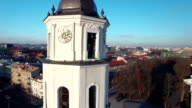 AERIAL. Smooth orbit flight around Vilnius Cathedral and Belfry Tower, Vilnius, Lithuania. 2015 winter video