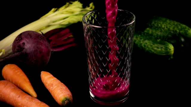 Smoothies from fresh cucumbers, carrots, celery and beets. Slow motion video