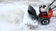 Snow blower clean snow from sidewalk in winter. Handheld. video