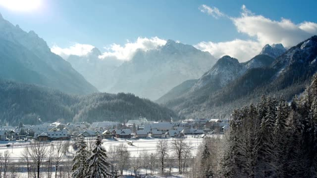 LD Snow covered alpine valley basking in the sun video
