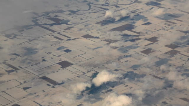 Snow Covered Fields from an Airplane Window video