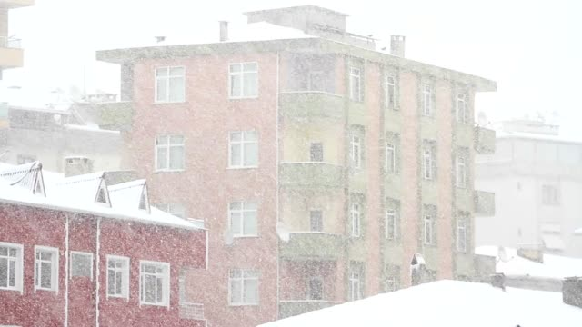 Snow falling in front of the living block of flats video