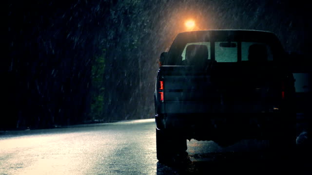 Snow Falling On Parked Truck At Night video