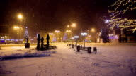 Snow falls in a christmass city video